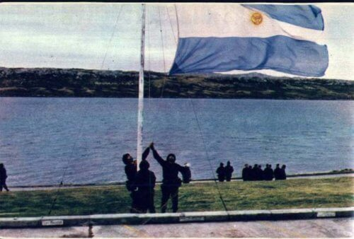 Argentinian flag being raised on the Falkland Islands