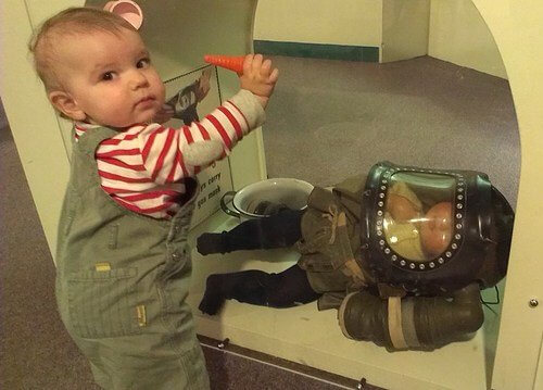 Small child with WWII baby gas mask