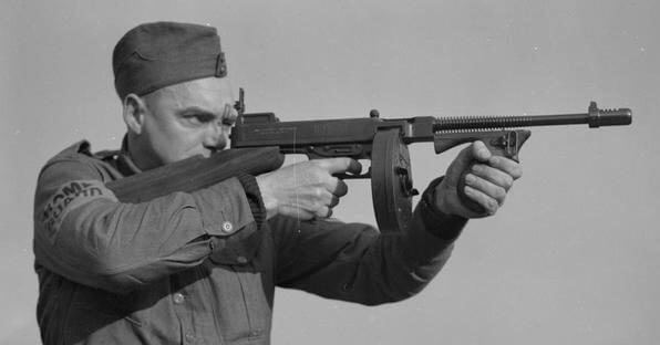 Guardsman aiming a Thompson submachine gun