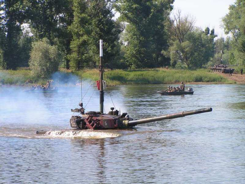 A snorkelling T-72 coming out of the water