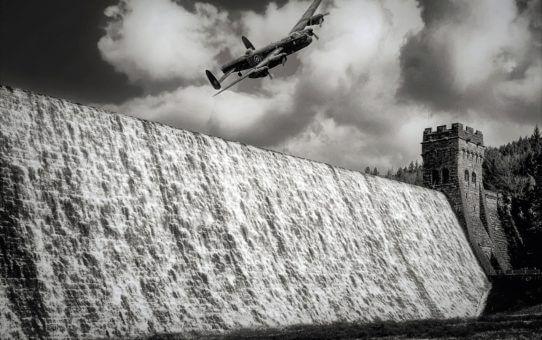 Lancaster bomber flying over a dam