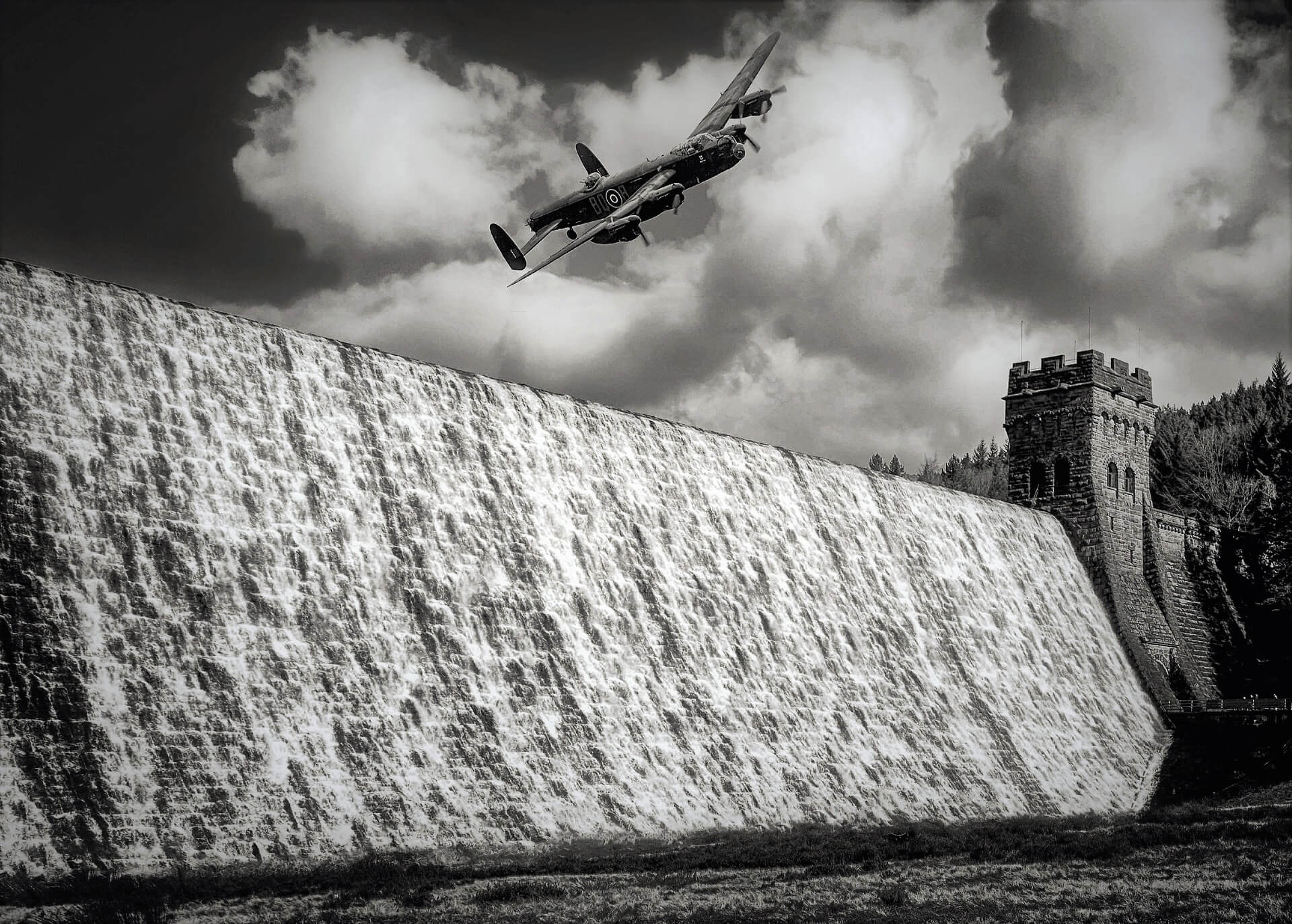 Lancaster bomber flying over a dam